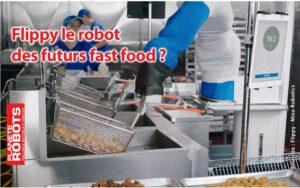 Un robot Flippy en train d'égoutter des nuggets