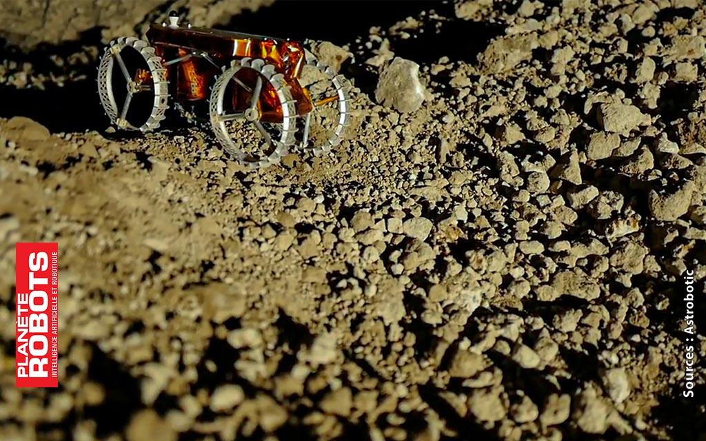 Le robot rover sortant d'un cratère artificiel